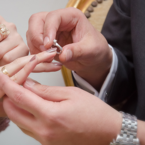 Putting on an engagement ring