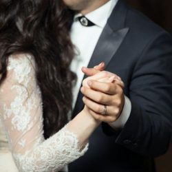Couple dancing at the wedding, the ohoto is zoomed in on them holding hands